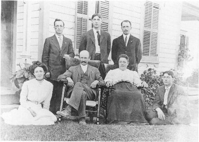1909: Arthur Chenevey on the far right. His parents Hubert and Mary sitting in the center. His sister and brothers are to the left of him.