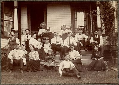 The Marthy Family picture. Grandma Chenevey is the young woman in the white blouse sitting on the bottom step.