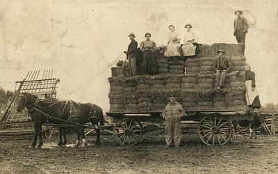 The Haywagon, The Marthey Family farm. Dated 1910. Josephine and her sister Priscilla are sitting on the top row of the hay.