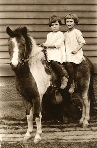 Mom (Dorothy) age 4, Betty age 3 on a neighborhood show pony. Photograph taken around 1924.