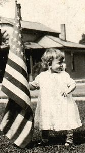 Dorothy Ray (mom) waving the flag