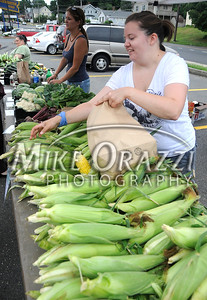 8/3/2011 Mike Orazzi | Staff Liz Cargill bags sweet corn from Green Acres Farm in Bristol during the Bristol Farmers' Market held at the Bristol Commons shopping center during the weekly Wednesday market.  *** for a Diane Sunday story ***