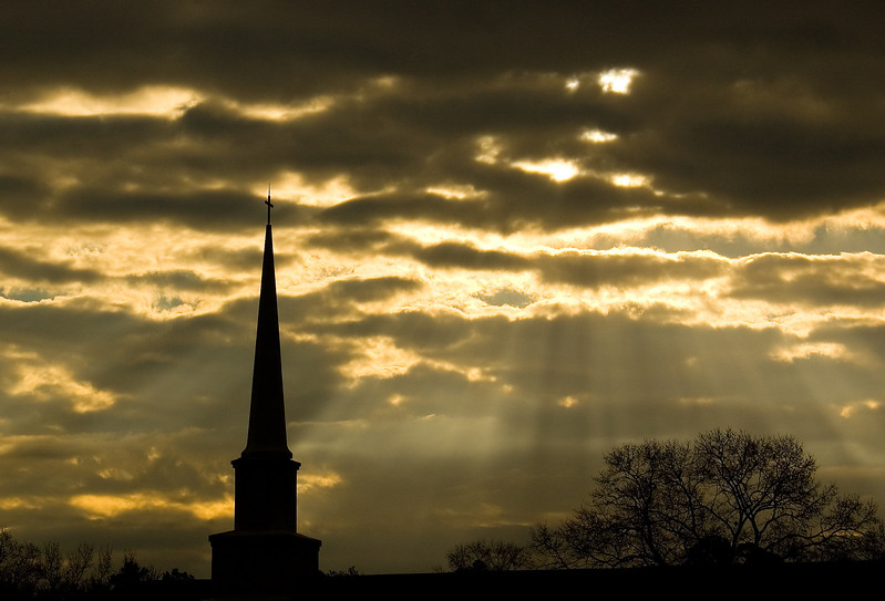 Sun rays behind the steeple