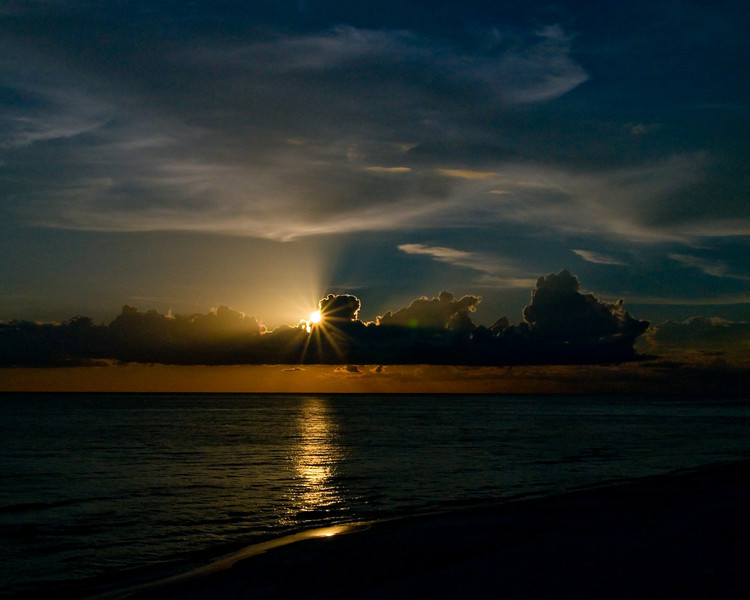 sunstar in the evening over the beach