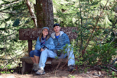 Patrick  & I on the bench. When sitting on it you felt like you would fall backwards down the hill. Good thing the tree was holding it up.