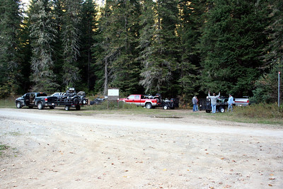 Everone loading up their ATVs after a fun day of riding.