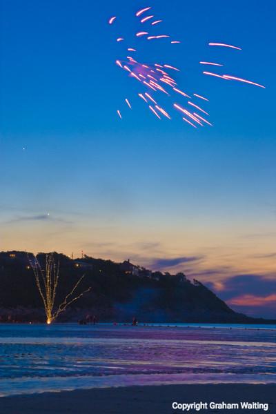 Fireworks at dusk, Plymouth Beach, MA, USA