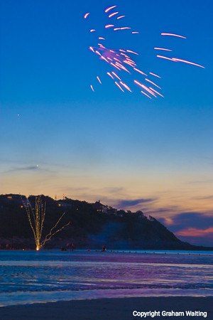 Fireworks at dusk, Plymouth Beach, MA, USA