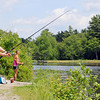 Chelsea Richard, 23, of Gardner and her friend Lindsey Noseworthy, 22, of Westminster tried to catch some fish at Round Meadow Pond in Wesminster on Tuesday afternnoon. SENTINEL & ENTERPRISE/JOHN LOVE