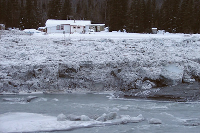 2/5/07 - While this house was beyond the reach of the ice itself, the driveway was flooded with ground-up ice floes and slush.