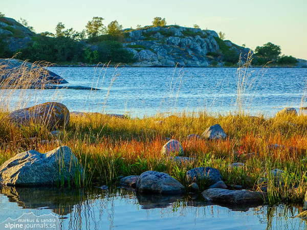 A quiet evening in the Stockholm archipelago, lingering for a while on the warm, flat rock before the sun sets on the horizon.