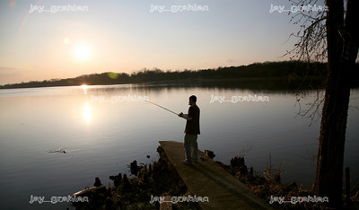 Robert Charboneau is seen re-casting his line while fishing for Crappie near his home on Lake Paradise off of East Lake Paradise Road in Mattoon, Illinois on Monday, March 16, 2009. Along with members of his family and friends, Charboneau caught several fish on the mid-sixties day.  (Jay Grabiec)
