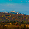 One of the many benefits of living in the Northeast Kingdom is that view right there, folks. Every morning, I walk out my door to Jay Peak and Lake Memphremagog (fog, weather, and visibility permitting, of course). We had a little snow in some of the higher elevations last weekend, which makes for a lovely contrast between the waning autumn colors and the impending winter blankets. It's almost a bridge season here, one of my favorite times as well as one of the most bittersweet, signaling the coming of snow (break out the snow shoes and nordic skiis!) and the end of another all-too-quick autumn.
