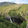 Dag 2, og vi er på vei opp fra Trollheimshytta mot toppen av Geithøtta (en fjelltopp, ikke en hytte... ;) ). Dagen starter strålende med sol og fine fossefall.