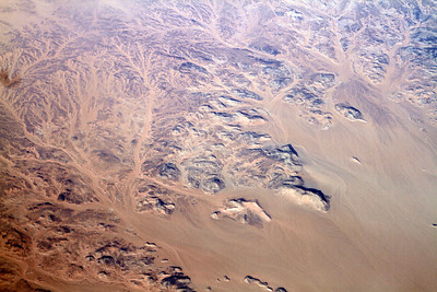 We're a few hundred miles into Egypt, now - almost to Sudan  And it's nothing but sand, sand, and more sand  But isn't this sand pattern pretty? Another place that looks like it was shaped by long-ago water