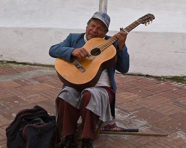 Street musician in Quito (note authentic native hat)