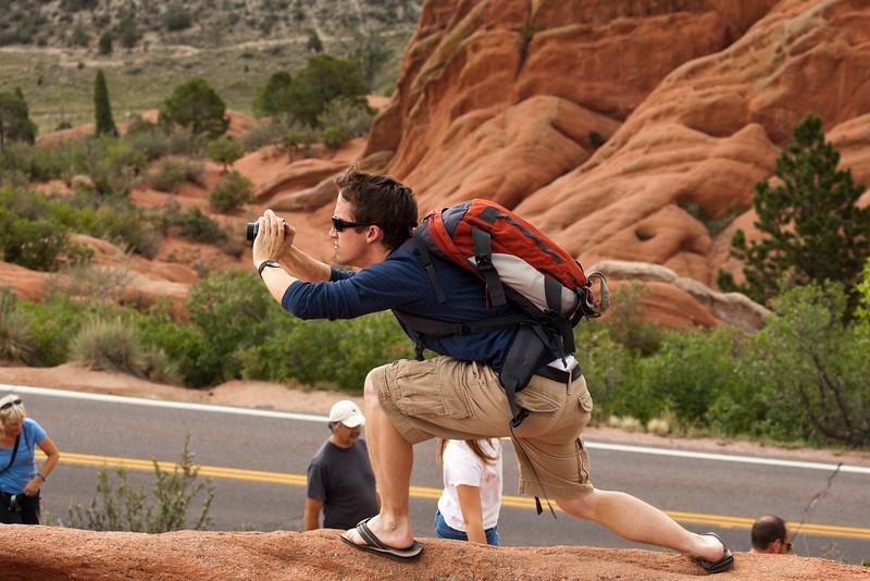 Jake doing a serious photographer pose.