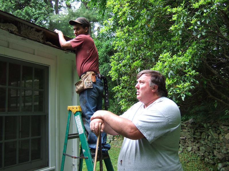 Ed McEneaney Repairs Flat Roof Soffit