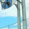 Oversized Goal <br /> The went overkill when constructed this basketball goal. Three huge pillars, a basketball-shaped backboard, a very heavy chain link net, and to top it off the goal is about twelve feet tall.