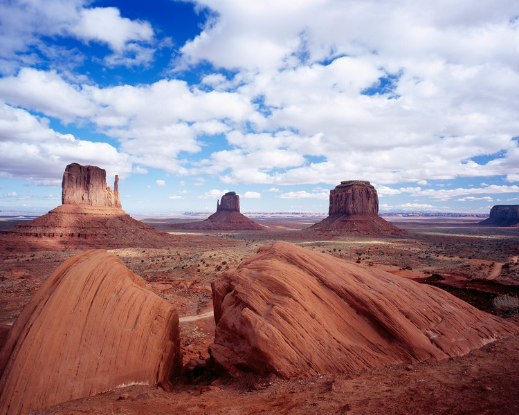 The Mittens of Monument Valley, viewed over the Ansel Adams rocks.