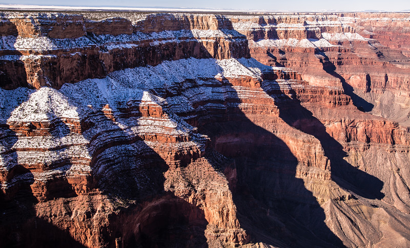Patterns, repetition, contrast.  The fresh soft, cold snow after a snowstorm, against the hard red rock of the South Rim, worn down over millions of years.