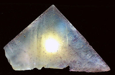 Fluorite. It's interesting how cubic shapes can cluster to form this beautiful pyramid-like shape. The light source was from below and produced the appearance of coming from inside; 8.7x 5.3x 6.3 cm.