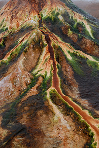© Joseph Dougherty. All rights reserved.   Geothermal geyser deposits minerals and has colorful thermophilic bacteria growing along rivulets of outflow.