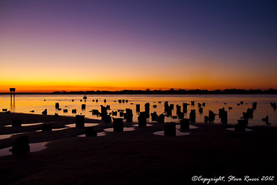 Old pier pilings at sunet along the St. John's River at Mayport.