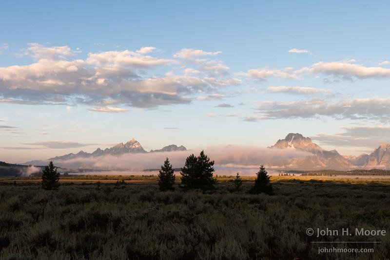 Morning low clouds over Jackson Lake in Grand Teton National Park, Wyoming.
