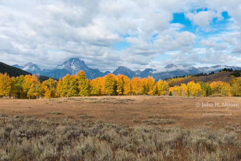 View of the Teton Mountains on a stormy fall day.  Grand Teton National Park, Wyoming, USA