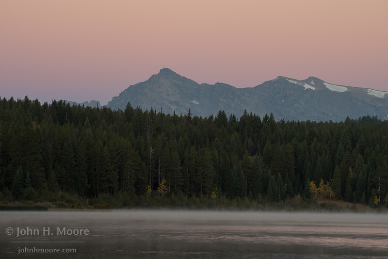 Pre-dawn light behind Two Ocean Lake in Grand Teton National Park, Wyoming, USA