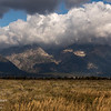 The tops of the Teton range are obscured by clouds on a blustery fall morning.  Grand Teton National Park, Wyoming, Utah.