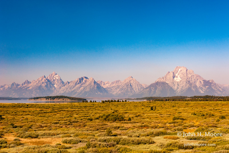The Teton Mountains as seen from Jackson Lake Lodge in Grand Teton National Park.  The gray hazy layer just above the mountains is smoke from massive wildfires in Idaho and the Western U.S.