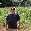 Mark Duffy, who leases Great Brook Farm, at one of his corn fields which will be seeded by helicopter with winter rye as a cover crop, to improve the soil. . (SUN/Julia Malakie)