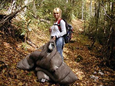 Dana holds shredded sleeping bag found along Forney Creek Trail. <br /> Reckon a Barr got dis?