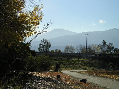 Mount Umunhum rises in the hazy air above the Guadalupe River Trail.