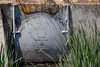 Apparently a large storm drain where it empties into the river, with a door to prevent backflow.