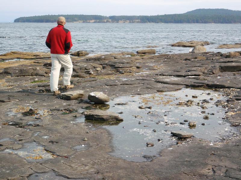 Roger walks the rocks.