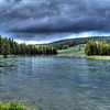Yellowstone River, Yellowstone National Park. Here rain clouds and the clear river water produced a surrealistic environment.