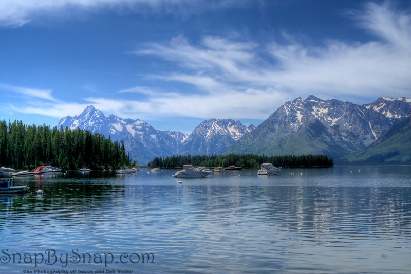 Boats at anchor in Jackson Lake in Grand Tetons National Park.