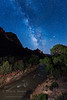The Virgin River runs down past The Watchman rock formation under a night sky.  Zion National Park, Utah.