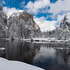 The Merced River flows past El Capitan and Bridalveil Falls in Yosemite National Park after a winter storm