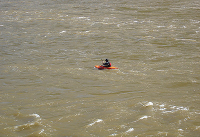 Kayaker on the now muddy Potomac river.