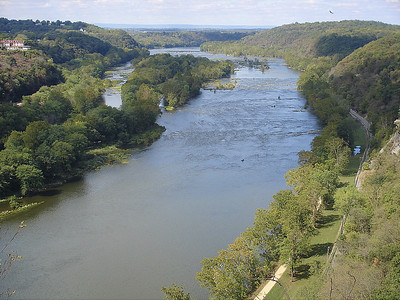 Looking west: left to right; Hilltop House (West Virginia), Potomac River, C & O canal towpath, canal and Sandy Hook Road.