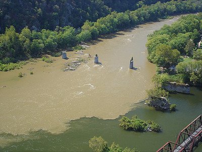 Confluence of the Shenandoah (r) and the Potomac (l) with remnants of bridge pilings. Because of the heavy rains from the past week the Shenandoah appears muddy. Both rivers were high.