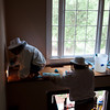 Bee Keepers Cleaning Up - Notice Rectangle Hole Under Window