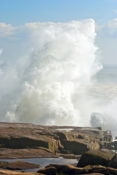 Sea spray shooting up 50 or 60 feet.