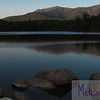 The Franconia Ridge reflected in Lonesome Lake on an uncommonly hot spring evening.