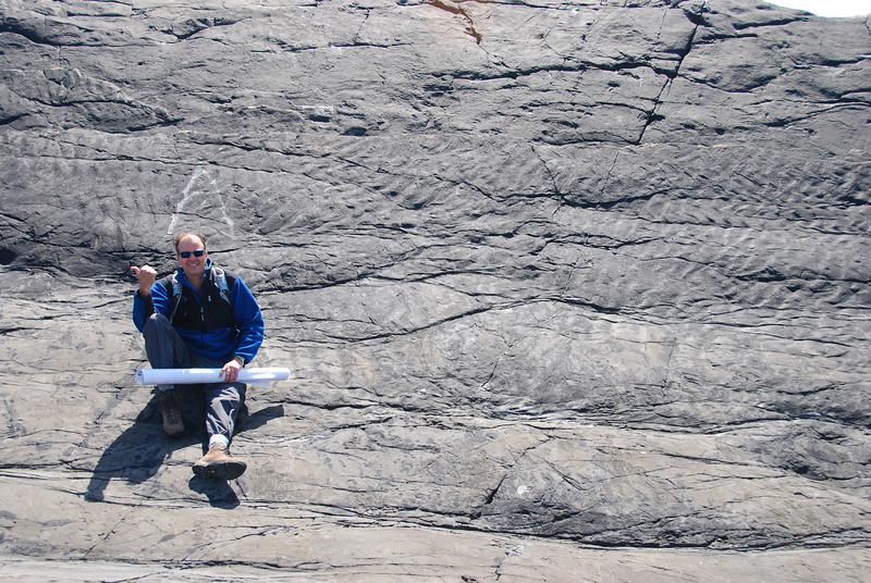 Ripple marks on the top of a sandstone bed in the Ross Formation, western Ireland. Carlos is pointing the way the currents were going.