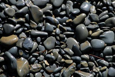 Shiny pebbles on a beach